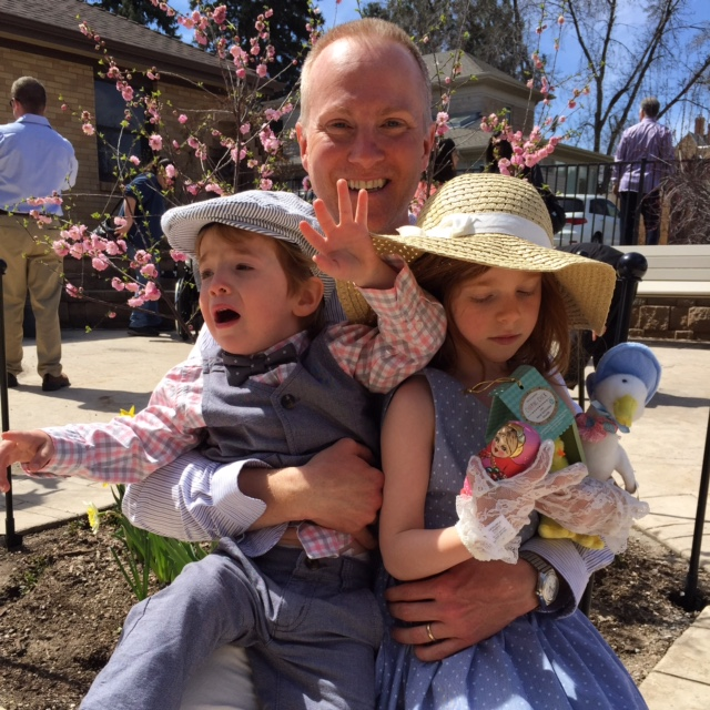 family Easter photo with screaming toddler and bored preschooler