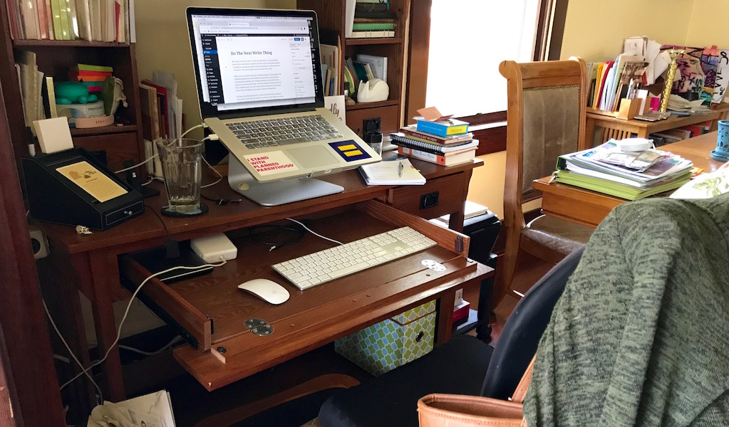 a color photo of my tiny writing desk in the corner of my dining room.